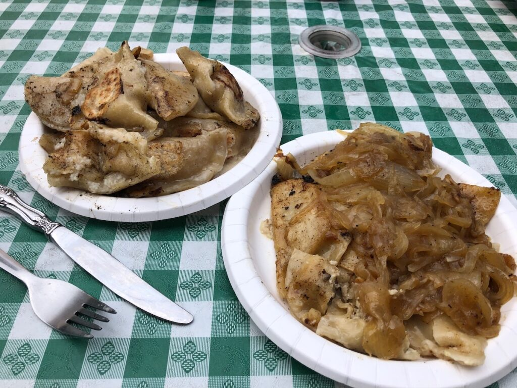 Pierogies, stuffed with a variety of fillings and topped with sautéed onions, are an iconic Pittsburgh treat.
