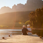 Retired couple sitting on dock