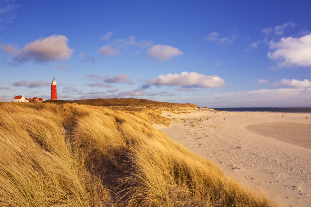 The lighthouse and sand dunes on Texel, Netherlands.