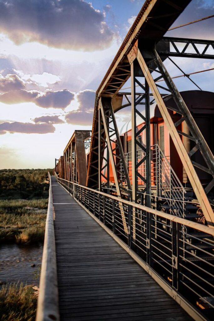 Train on bridge as sun sets in Kruger Shalati.