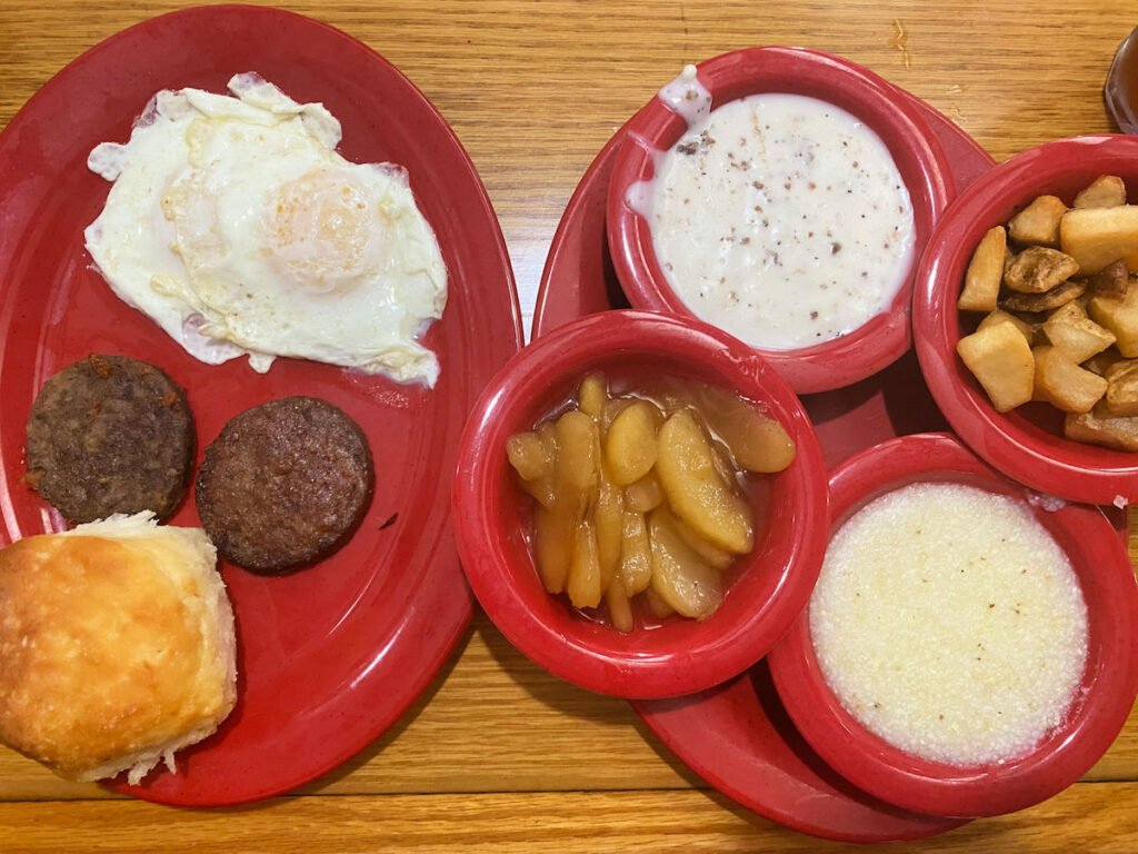 Breakfast goodies in separate red plates and bowls at Applewood Farm Restaurant.