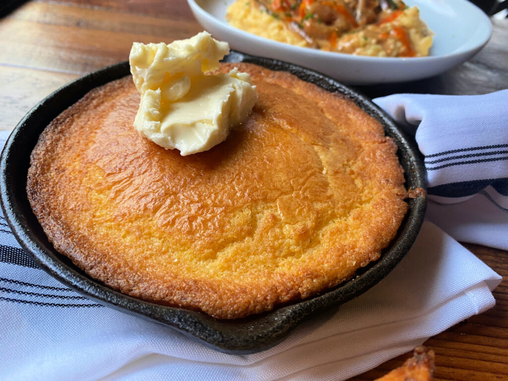 Cornbread with spoonful of melting butter on top , at he Appalachian.