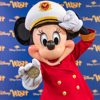 The commemorative coin created for the Disney Wish features Captain Minnie, who made her debut aboard Disney Cruise Line ships in 2019.