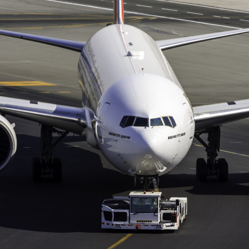 Passenger airliner being towed.