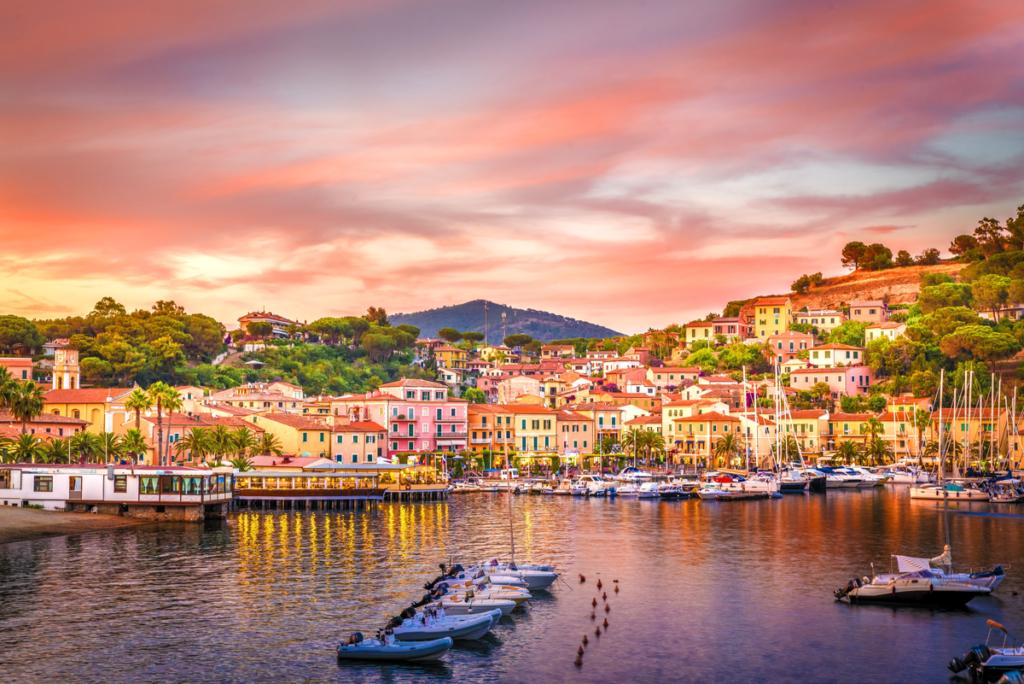 Harbor and village Porto Azzurro at sunset, Elba island, Italy.