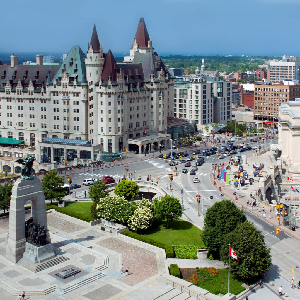 Aerial view of Ottawa's Cenotaph and Chateau Laurier on a sunny afternoon.