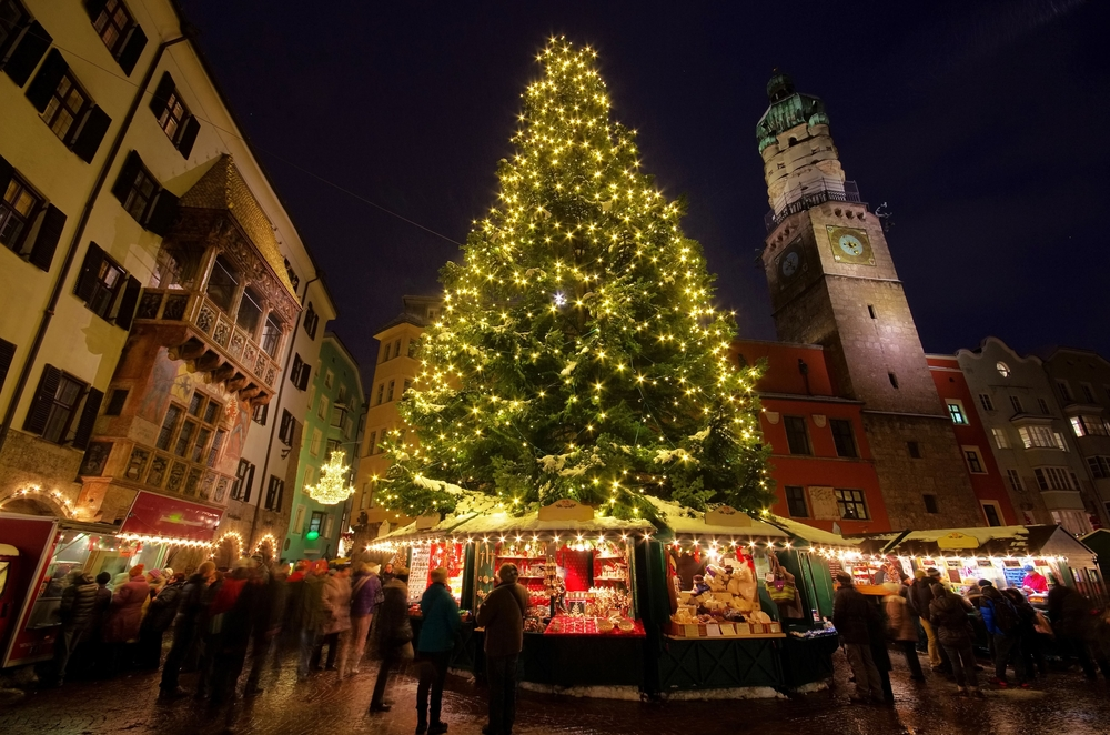 Innsbruck Christmas market large lit up tree and golden roof