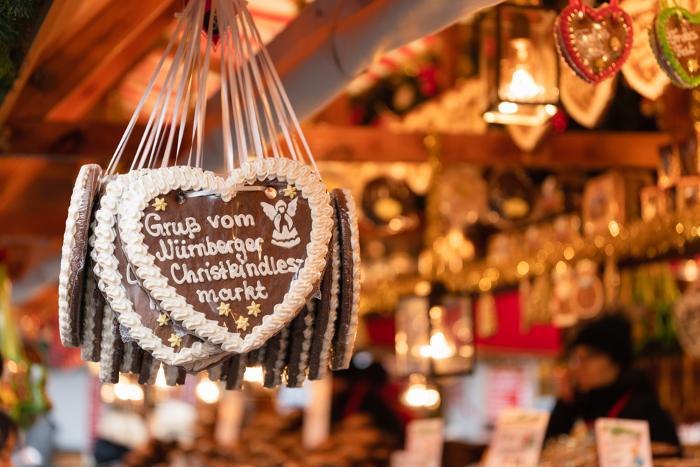 Nuremberg, Bavaria / Germany - December 05 2018: Traditional Gingerbread heart cookie (Lebkuchenherz) with sugar icing at famous Christmas market saying Greetings from Christkindlesmarkt Nürnberg