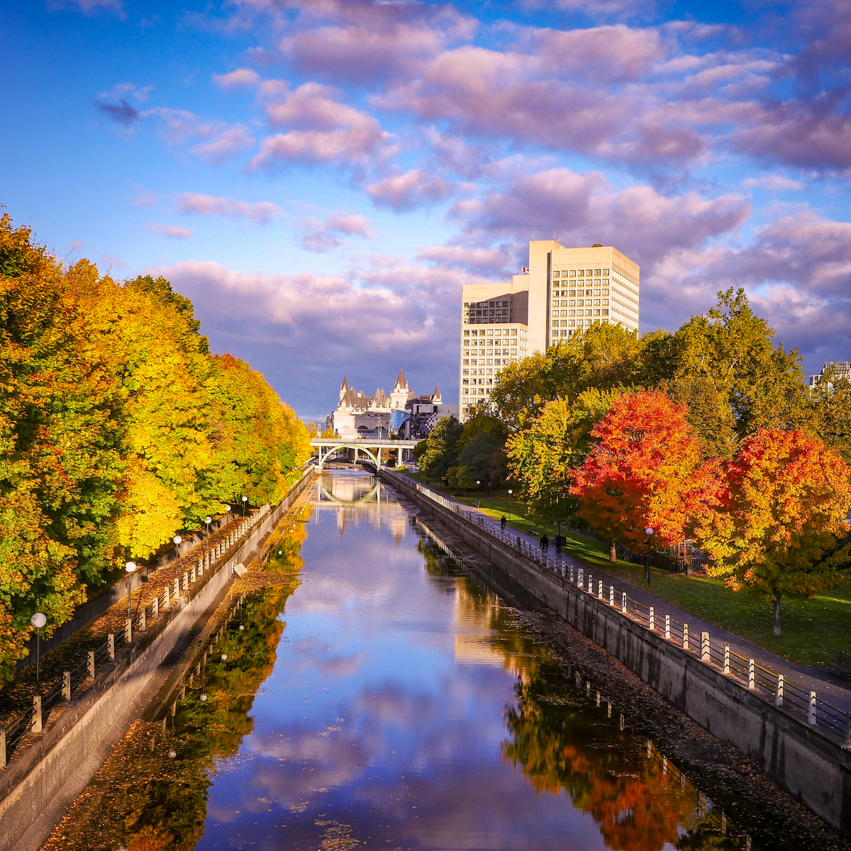 Ottawa's reflection off the Rideau Canal, Canada.