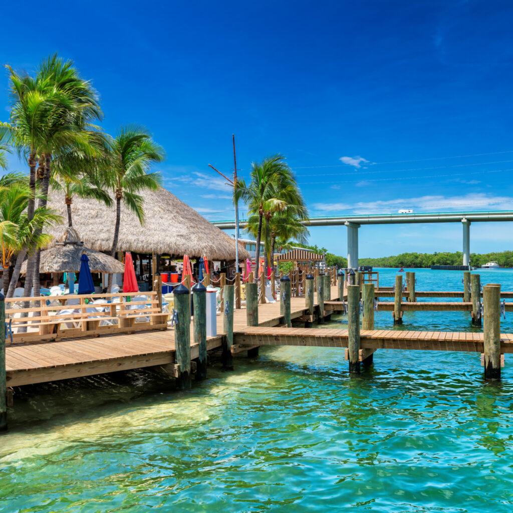 Tropical beach and pier on sunny beach in Key Largo, Florida keys islands.