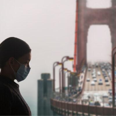 Women with mask near Golden Gate Bridge, San Francisco.