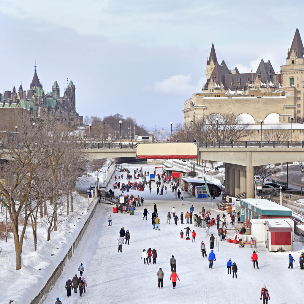 People ice skating on the Rideau Canal in Winter, Canada.