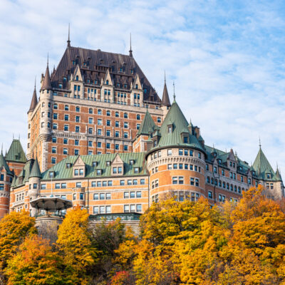 Frontenac Castle aka Fairmont Le Château Frontenac in old Quebec with fall foliage in foreground