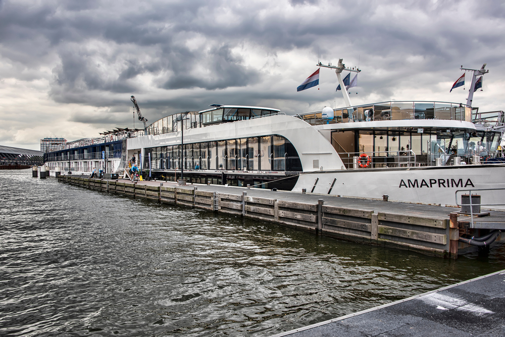 Amsterdam, The Netherlands - July 13, 2017: The Amaprima, part of the Amawaterway River Boat fleet, docked in Amsterdam as part of a Rhine River cruise.