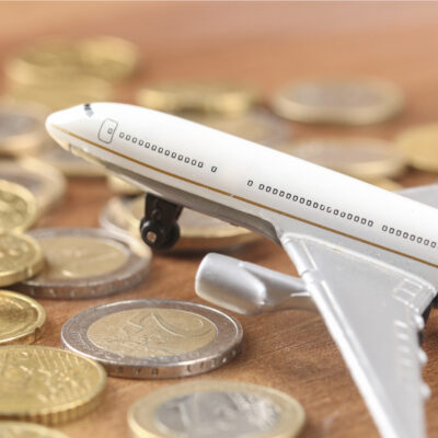 Model airplane on a display of coins.