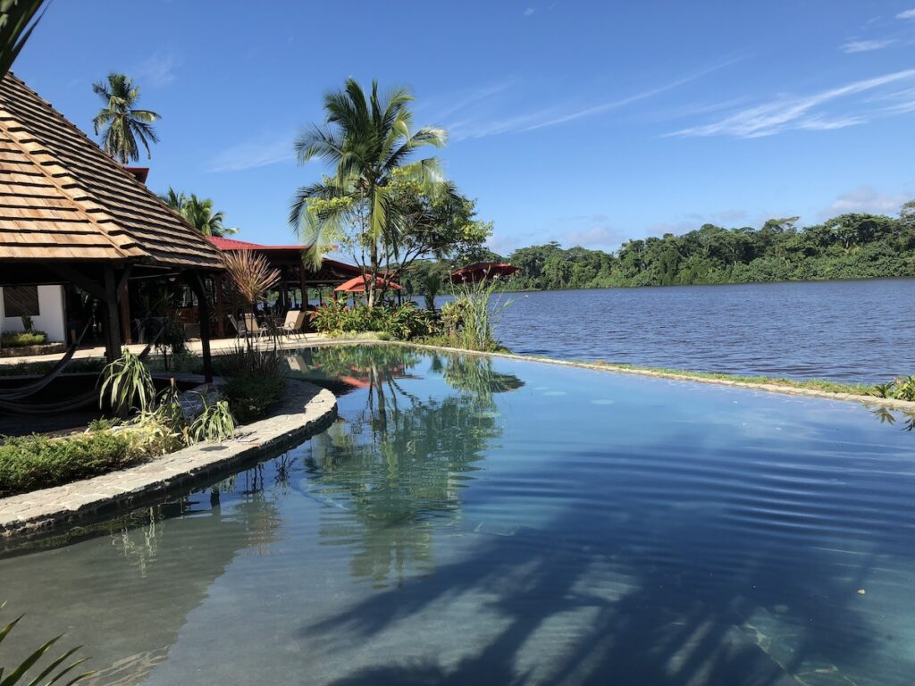 Tortuga Lodge and Gardens in Tortuguero, infinity pool and waterfront.
