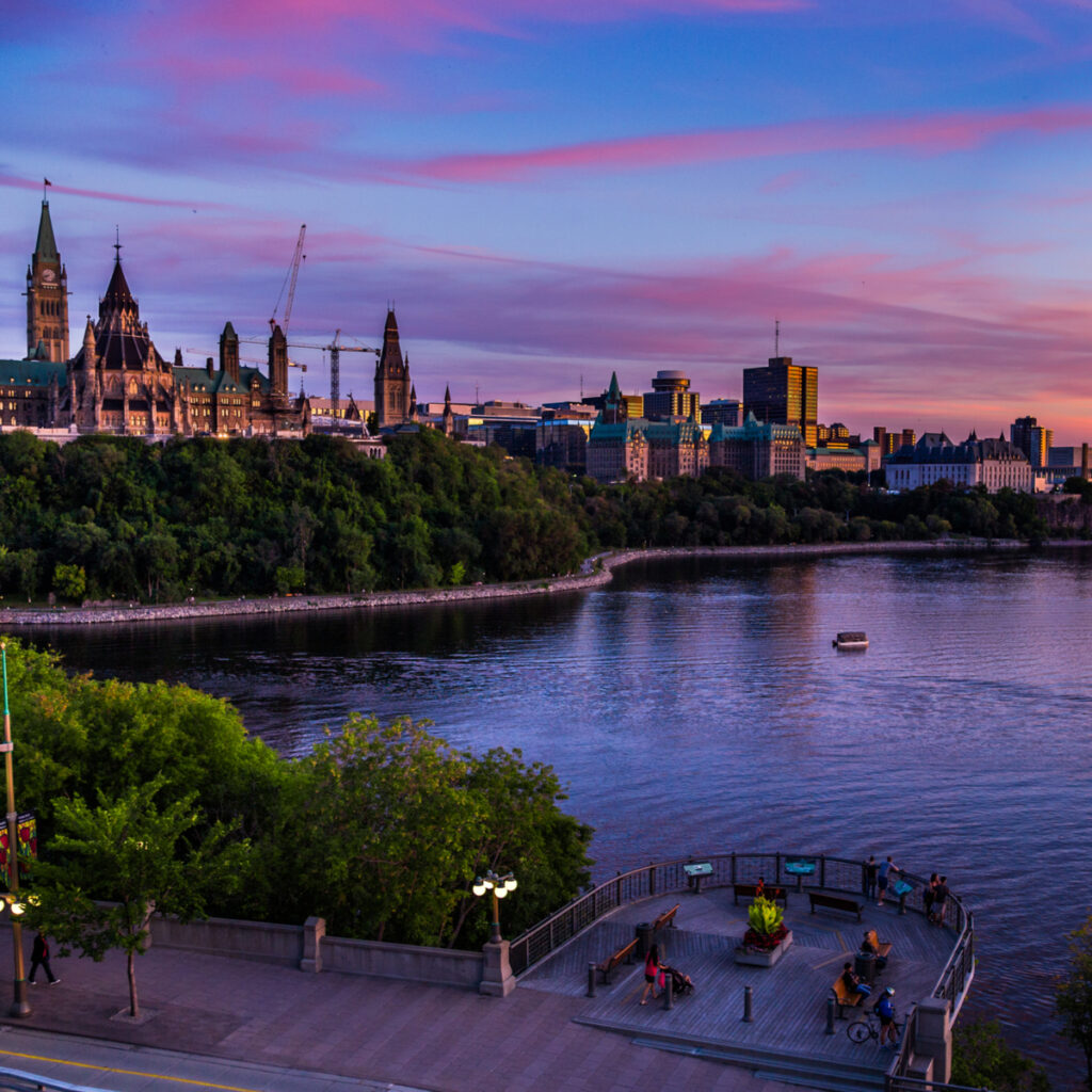 Canadian Parliament buildings across the Ottawa River.